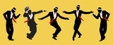 Elegant men wearing hats. Dancing swing or jazz. 1950s or 60s style.