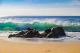 Huge ocean waves crushing on rocks in Garrapata State Beach in California, USA