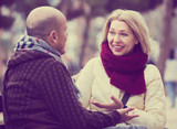 Mature couple chatting in street