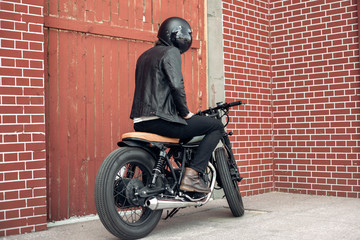 Biker and vintage custom motorcycle © Kaponia Aliaksei
