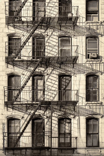 Typical Old New York City Building With Fire Escape Ladders Antique Look Processed
