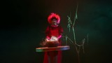 young beautiful cheerful witch with red hair makes witchcraft 08