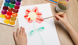 Children painted watercolor flower