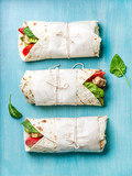 Healthy lunch snack. Tortilla wraps with grilled chicken fillet and fresh vegetables
