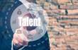 Businessman pressing an Talent concept button on a circular disp
