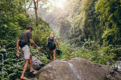 Couple hiking on mountain trail