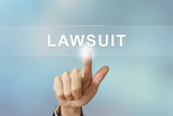 business hand clicking lawsuit button on blurred background