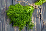 Bunch of fresh organic dill on the rustic wooden table - 115240291