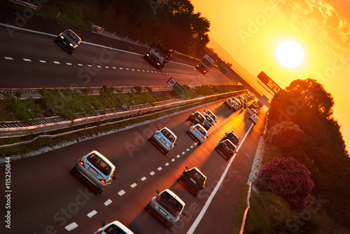 Foto op Plexiglas New York TAXI cars in the highway at sunset
