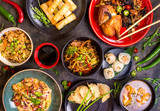Fototapety Assorted Chinese food set. Chinese noodles, fried rice, dumplings, peking duck, dim sum, spring rolls. Famous Chinese cuisine dishes on table. Top view. Chinese restaurant concept. Asian style banquet