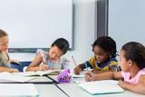 Schoolchildren writing on books