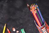 Colored pencils inside a shoe top view
