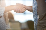 Colleagues shaking hands in creative office