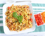 Bhel puri, an Indian healthy, traditional and popular snack, made from puffed rice and items like tomato, onion and cucumber.