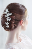 Wedding hairstyle with decoration, rear view
