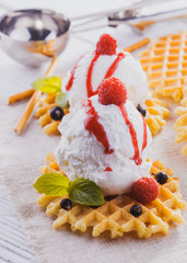 Ice Cream with Mint and waffles. Homemade Organic product. On the wooden table.
