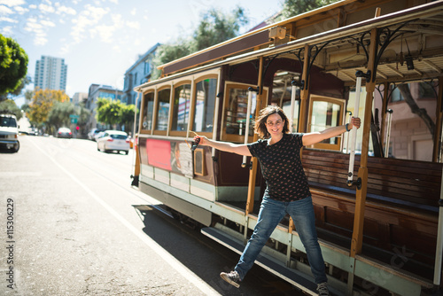 Poster Young woman on cable car, San Francisco