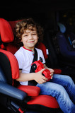 baby boy sitting in a car seat