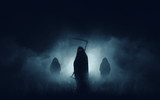 Grim reaper, the death itself, scary horror shot of Grim Reaper in fog holding scythe