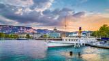 Fototapety Historic city center of Geneva with paddle steamer at sunset, Switzerland