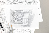 hand drawing sketch of home interior with pencils and blueprints