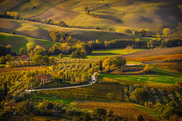 An idyllic panoramic view over the countryside of Montepulciano, Tuscany, Italy, bathed in the beautiful autumn sunset light