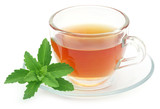 Herbal tea in a cup with stevia leaves