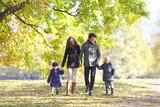 Family in autumn par...