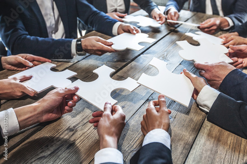 Fototapeta Business people and puzzle