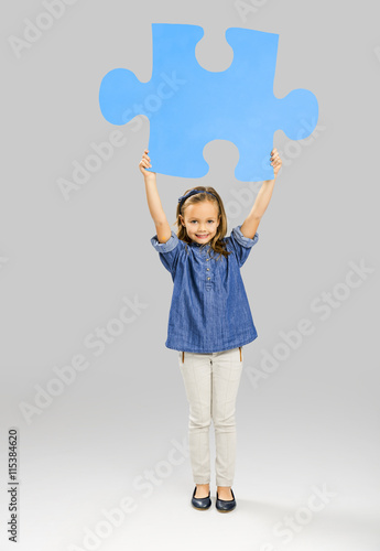 Girl holding a puzzle Poster
