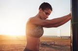 Fitness female taking break from intense workout