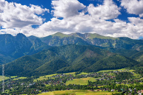 View of village, valley and mountains, Tatra, Poland.