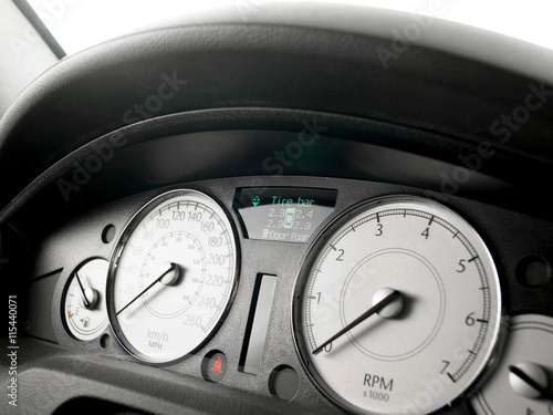 Poster Closeup of a speed meter of a car