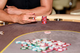 Closeup of hands of poker player with chips on poker table, sele - 115455653