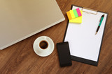 Office workplace with laptop, smart phone and coffee cup on wood table - 115464038