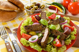 Beef salad on the plate. Grilled beef meat with tasty selection of vegetables.