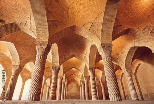 fototapeta na ścianę Persian mosque Vakil with carved columns in huge historical hall, Iran