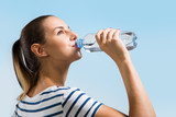 Fototapety Young woman drinking water