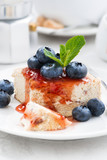 cheesecake with berry jam, vertical closeup