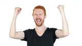 Joyful young man gesturing ,happiness ,success, good news ,white background