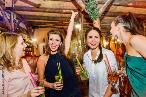 Zdjęcia na płótnie, fototapety, obrazy : Young beautiful women with cocktails in bar or club