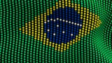 Flag of Brazil, consisting of many balls fluttering in the wind, on a black background. 3D illustration.
