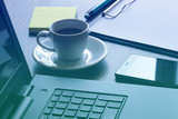 Office workplace with laptop, smart phone and coffee cup on table - 115553278