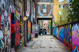 Fototapety Colorful street art in Graffiti Alley, in the Fashion District o
