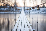 Fototapety Locks on a rope bridge over frozen water