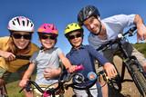 Fototapety Portrait of happy family on a biking day