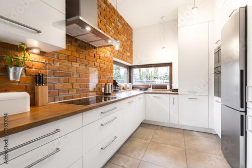 Modern designed kitchen with brick