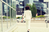 african american businesswoman walking in city