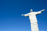 Corcovado Christ the Redeemer statue standing under bright tropical sun blue sky Rio de Janeiro Brazil