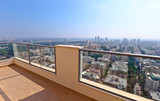 balcony in downtown of modern city - 115639487